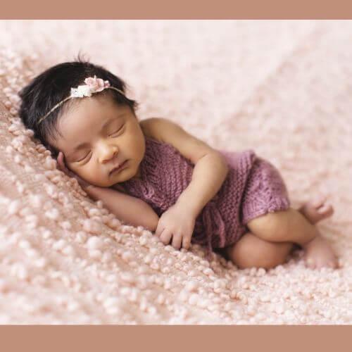 Female infant sleeps peacefully
