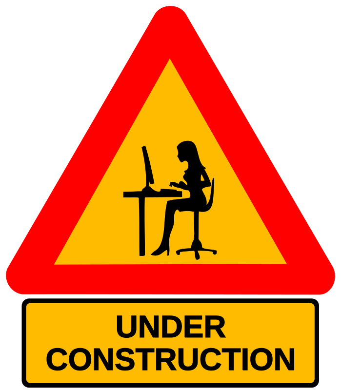 Construction sign with a woman at a keyboard